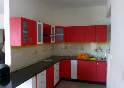 L shape kitchen in combination of Red and White